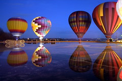 Balluminaria, Eden Park (waxinggibbous) Tags: blue ohio red water beautiful yellow night reflections catchycolors fire still nikon bravo pretty glow basket purple colorfull cincinnati edenpark mirrorlake clear flame heat d100 geotag hotairballoons inflated clearnight 10millionphotos balloominaria regionwide