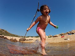 little wild girl (wild friday) Tags: sardegna family sea wild vacation italy sun holiday childhood relax fun mediterraneo mare sardinia play sole vacanze gioco caldo