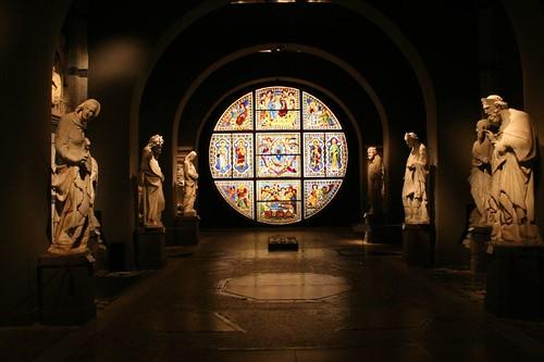 Duccio's stained-glass window and Giovanni Pisano's facade decorating statues