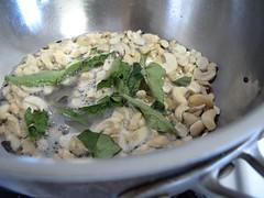 Split black gram- mustard seeds- cashews and curry leaves in groundnut oil for Upma.jpg