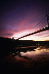 St Johnsian dreams (Zeb Andrews) Tags: oregon portland bridges sunsets rivers pacificnorthwest nikonfm2 willametteriver fujivelvia50 stjohnsbridge bluemooncamera historicbridges zebandrews zebandrewsphotography
