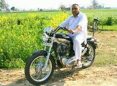 Bullet Motorcycle (Manny Pabla) Tags: travel winter vacation people india heritage rural canon landscape rebel asia village indian culture desi motorcycle bullet punjab punjabi royalenfield northindia greenrevolution pind panjab saini canoneosdigitalrebelxti garhshankar