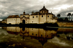 Monasterio de la Cartuja (in a dark day) (cmedrang) Tags: espaa reflection sevilla andaluca spain agua reflejo estanque dragan monasterio cartuja superaplus aplusphoto cmedrang travelerphotos superhearts
