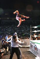 ...hector garza flying to attack la parka... (angelferd) Tags: sports flying jump holding wrestling attack ring hector arena event freeze luchalibre ropes wrestlers monterrey lucha libre garza angelortega angelferd