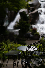 a lovely place to sit and think (getthebubbles) Tags: seattle waterfall washington chairs may 2007 10things seattleflickrmeetup getthebubbles waterfallgardens sonyalphadslr