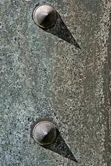 vault door spiked studs (Leo Reynolds) Tags: shadow cemetery canon eos 350d iso400 verdigris f95 135mm 10up3 doordetail 0003sec cemeterymontparnasse hpexif groupdoordetails groupverdigris leol30random 05ev 30000th xleol30x xxx2007xxx xratio2x3x