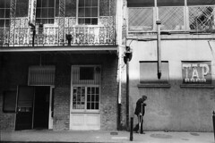 tap (chuckp) Tags: blackandwhite bar balcony neworleans sthcsp lunchtime frenchquarter crutch leicam2 scanfromprint 50int monostreet oldsilver