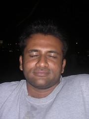 Venkat (Ravages) Tags: lighting light sea portrait india beach lights eyes sand friend nightout madras sleepy snack mugshot chennai indianarchive tamilnadu besantnagar bessy venkat venky indianness avkvenkat ithepeople