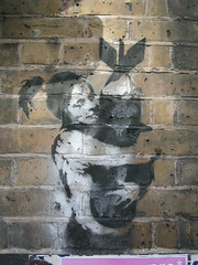 banksy girl with bomb (squeezemonkey) Tags: london girl wall graffiti stencil bricks banksy bomb