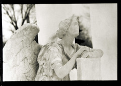 Graceland Cemetary (* Sontheimer Pictures *) Tags: blackandwhite bw sculpture film cemetery statue darkroom dead death sadness interestingness interesting kodak rip cemetary trix tomb tombstone final restingplace manual process graceland grief gracelandcemetary sjs2 jls11 jrs7