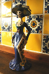 La Catrina in Guadalajara, Mexico with traditional yellow and blue tiles, de Mxico (Wonderlane) Tags: trip travel flowers blue summer sculpture hot art halloween yellow mxico lady mexico fun death warm folk traditional may guadalajara celebration mexican figurines tiles kra052 wisdom elegant catrina enjoyment happyhalloween calavera statute catarinas wonderlane ladydeath devilinabluedress flowerofdeath demxico lacatrinainguadalajara mexicowithtraditionalyellowandbluetiles classiclacatrina classiclacatrinastatue lacaterine lacaterina mexicosladydeath httpwwwwildtravellerscom lacalaveracatrina mexicanfolkartcatarinas lacatrinafigurines imagendelacatrina
