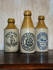 Three pictorial ginger beer bottles. (Colonel Blink) Tags: colonelblink bottle bottles earthenware antique vintage stoneware old logo trademark capetown southafrica waterfoot darlington gingerbeer england