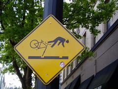 Over the Handle Bars (earthdog) Tags: 2004 bicycle sign 1025fav portland stickman olympus monthlyscavengerhunt portlandor streetcar pictogram msh u300d olympusu300d