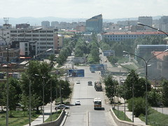View towards central Ulaanbaatar (dumell) Tags: street city urban bus cars buildings traffic mongolia dust ulaanbaatar ulanbator ulanbatar ulaanbataar