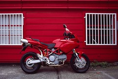 Red on red (Ducati at Ivey photo, Seattle) (artandscience) Tags: canon fd provia motorcycle ducati multistrada film bike red rouge