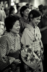 Watching the Matsuri (Jim O'Connell) Tags: blackandwhite bw film japan darkroom tokyo nikon mine availablelight nikonf matsuri kagurazaka mmdc