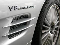 Mercedes V8 Kompressor (mnadi) Tags: auto reflection cars car metal silver reflections mercedes automobile parking wheels curvy grill german rim rims gill v8 automobiles metalic amg alloy gills sl55 crome merc kompressor