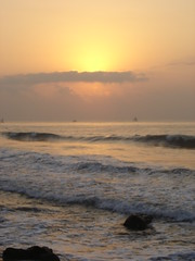 getting there (Atheistbishop) Tags: beach vizag sun rise orange water shore horizon rocks