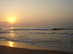Sun rise (Atheistbishop) Tags: beach vizag sun rise orange water shore horizon rocks