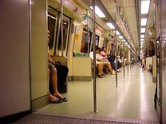 Legs At The Bars (Spacecake) Tags: massrapidtransit legs singapore bars trains passageways utatagettingaround