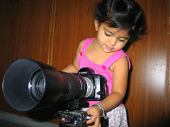 Sukhi - a Budding Phototgrapher! (Captain Suresh Sharma) Tags: camera family red portrait people baby india girl beautiful training canon lens photo kid photographer child daughter bracelet curious pinkshirt punjabi panjabi macrolens canoneos3 longlens buddingphotographer lenshood canoncamera sukhmani silverbracelet femalephotographer youngphotographer talentedkid canonmacrolens childphotographers girlphotographer sikhbaby telented talentedgirl captsureshsharma talentedchild canon180mmlseriesmacro prodigygirl prodigychild skilfulchild prodigykid telentedchild exploringcamera