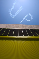 UP (Orrin) Tags: california blue sky green up yellow metal wall architecture losangeles lenstagged downtown factory wideangle minimal conventioncenter minimalism topf150 1022mm corrugated skywriting xgames topv6666 sr80 canonefs1022mmf3545usm fsftsblog cotcmostinteresting topvaa tccomp066 tcomp066