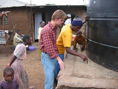 Kiswahili lessons by a community water tank in Kibera slum, Nairobi, Kenya