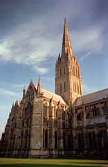 Salisbury Cathedral in afternoon light (Cameron Booth) Tags: vacation clouds 1025fav geotagged europe cathedral unitedkingdom medieval historic spire fv10 1997 salisbury interestingness163 i500 explore18aug2005 geo:lat=51064082912253 geo:lon=17969735643116