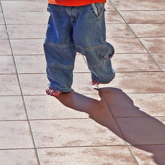 me & my shadow (Brenda Anderson) Tags: boy shadow toes pants pcss tiles baggy curiouskiwi ssmyshadow utatawalksthisway brendaanderson curiouskiwi:posted=2005
