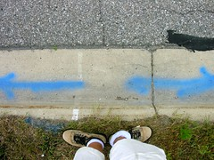 Almost (O Caritas) Tags: road people selfportrait feet me grass self shoes boots pavement busstop shorts arrow curb waitingforthebus standingthere blacktop ocaritas collinsroad