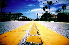 Middle of the Road (kagey_b) Tags: road film lines yellow topv111 interestingness lomo lca xpro lomography crossprocessed xprocess 500v20f stripes explore xp mostinteresting jessops100asaslidefilm e6 interestingness9 sr146 i500 srvanishingpoint