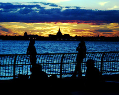 Sunset over Ellis Island (rleffel) Tags: ellisisland batterypark sunset sun colors newyorkcity nyc manhattan park outside outdoors water people light yellow bluw orange ellis island evening fantastic fivesenses been1of100