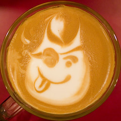 pirate con leche (Chris Blakeley) Tags: seattle eldiablo coffee latte crema latteart conleche pirate smiley squaredcircle