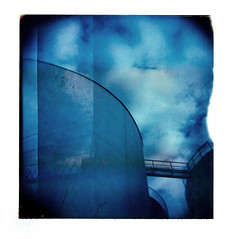 bridged (seventytw0dpi) Tags: bridge blue sky calgary clouds polaroid holga doubleexposure toycamera silos holaroid fvdoubleexposure