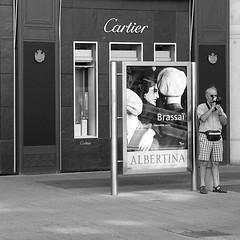 in front of the poster of his idol (elfis gallery) Tags: vienna wien street city people urban blackandwhite bw white man black home monochrome publicspace poster grey austria sterreich photographer outdoor streetphotography posters sw athome schwarzweiss weiss schwarz mycity inpublic scharzweiss graustufen schwarzundweiss bilderfantasien decicivemoment peopleoutdoor todolist1 postersandpeople