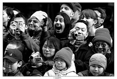 Illustration of Enthusiasm (Arnold Pouteau's) Tags: nyc bw newyork chinatown chinese 2006 newyear parade f25 100bestbwphotojournalism