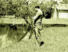 (rachel !!) Tags: trees bw house man sexy guy water look standing outside pond arms think profile bodylanguage contemplate 1on1peoplephotooftheday 1on1peoplephotoofthedayapril2007