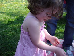 Little Girl with Caterpillar at Earth Day Festival