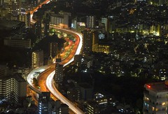 Through Tokyo flows a river... (NavindaK) Tags: road longexposure red white cars japan night buildings river geotagged lights tokyo amber highway trails ikebukuro lighttrails roads taillights r5 tokyobynight top20longexposure exressway geo:lat=357272 geo:lon=1397163