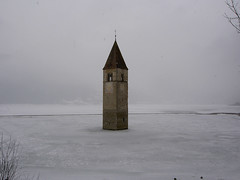 Church in Frozen Lake. (Maxey) Tags: italy alps austria tirol sdtirol reschenpass trafoi diresia wintersports2007