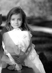 Maeve (*Diane) Tags: portrait blackandwhite bw girl beautiful ruffles nikon child searchthebest bokeh chiffon 45 explore barefoot parkbench firstcommunion cutelittletoes zippitydodah superhearts tribeofbeautyfreedompeace thatsmirkisdirectedatme thislittlepiggywentwheeeeeeeeallthewayhome purplesash