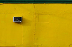 yellow obsessed (xgray) Tags: street color green texture colors lines yellow wall digital canon austin 350d texas stripe neighborhood airconditioner rebelxt thewall ilmuro 51st ef2470mmf28l bananabaytradingcompany dedicatedtoyellow