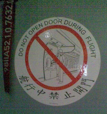 China Air in flight safety sticker on door
