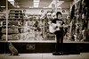 Dollar Store Music (Kat Hatt) Tags: dollarstore guitar musician dog store man kingston canada busker matchpointwinner t518