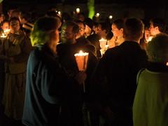 Lighting the torches (Hindolbittern) Tags: uk england catholic religion norfolk olympus walsingham vigil candlelit evolt e500 eastersaturday studentcross
