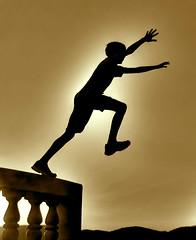 Climbing the invisible stairway (Igor Alecsander) Tags: sunset sky people gabriel silhouette brasil sepia backlight contraluz flying kid jump jumping action stairway cielo salto saltando puestadesol chico silueta cruzeiro tones pulo ceu menino valena pordesol bugiu abigfave