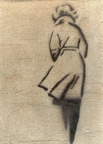 stencil graffiti: woman in a coat, walking away