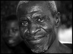 portrait of an old man (LindsayStark) Tags: africa travel portrait blackandwhite men war sierraleone conflict elders humanrights humanitarian displaced idpcamp refugeecamp idps idp humanitarianaid emergencyrelief idpcamps waraffected