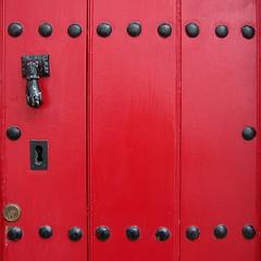 ::::::::: (MayteVidri (busy / ocupada)) Tags: street door travel viaje red espaa black closeup architecture square punto calle andaluca spain rojo arq