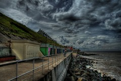 Sheringham Seafront (David Swales) Tags: shadow sea cloud storm green beach clouds canon coast amazing interesting saturated surf purple foreboding norfolk perspective dramatic explore hut seafront sheringham eastanglia jesters swales flickrsbest hdrsingleraw 400d abigfave canon400d tainotribe